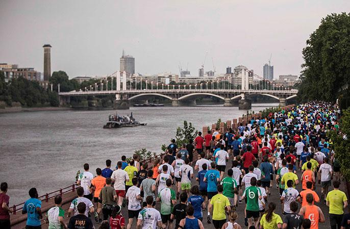 Runners embark on the 2017 London JPM Coporate Challenge beside the Thames River
