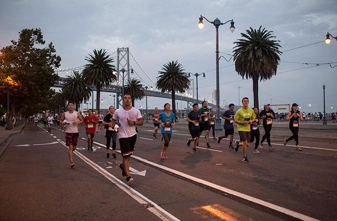 Photo: Runners going down the road feeling GOOD in San Francisco during the 2017 JPM Corporate Challenge.